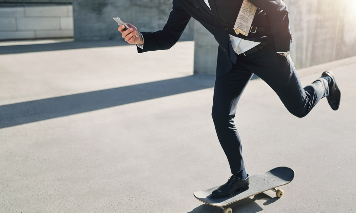 businessman on skateboard, high-risk businessman